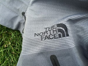 North Face logo woven into the reinforced shoulder panel